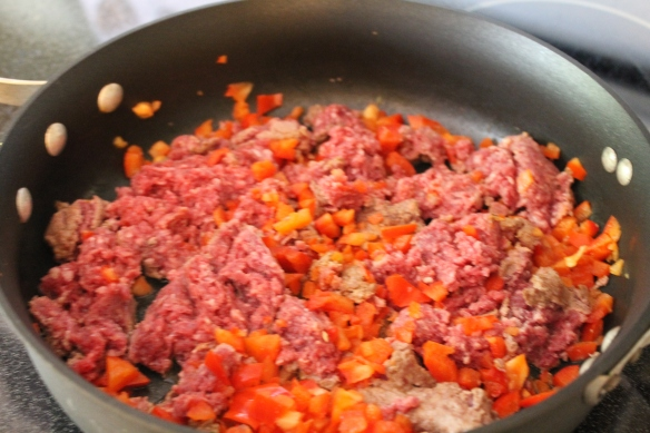 Browning meat and peppers